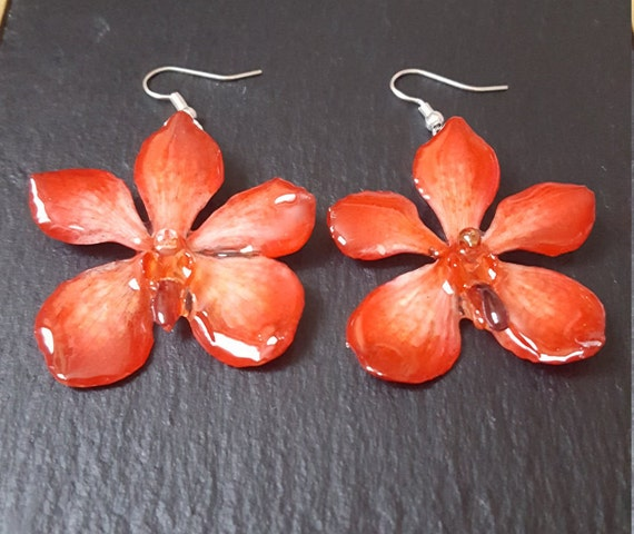 real orchid mokara flower earrings in red