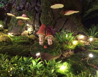 Miniature Sculpture of Toadstools With Faces On Moss With Butterfly