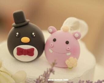 Hippo and penguin wedding cake topper