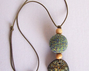 Beautifully mystique jewel with the Tree of Life ceramic pendant, light to wear.