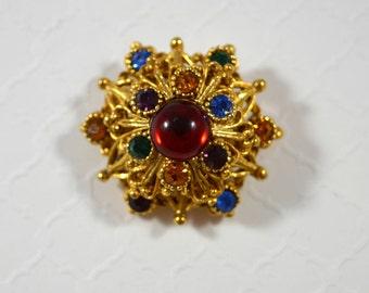 Vintage Jewel Toned Starburst Domed Pin Brooch Jewel Toned Rhinestones Cabochan Center Goldtone Filigree Accents Domed Brooch