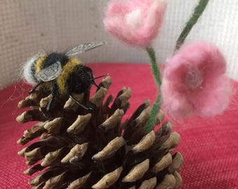 needle felted bumble bee on pine cone with a flower