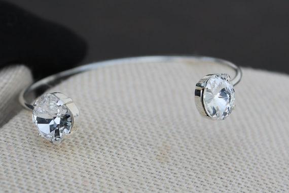 Open bangle cuff bracelet features a 12mm Cushion Cut Square Swarovski Crystal and a 12mm Rivoli Round Swarovski Crystal