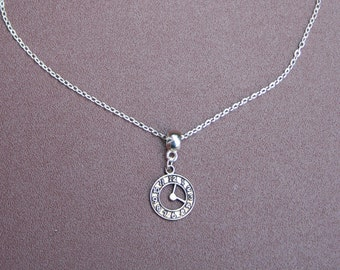 "Silver-plated clock necklace. 9.5 "" chain."