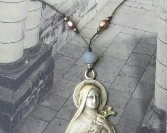 Silver antique Saint Theresa bust pendant .