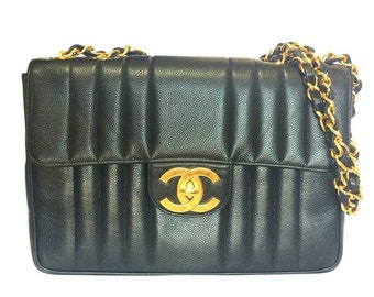 Vintage CHANEL black 2.55 jumbo caviar leather large shoulder bag with golden CC Vertical stitch. Classic caviar leather