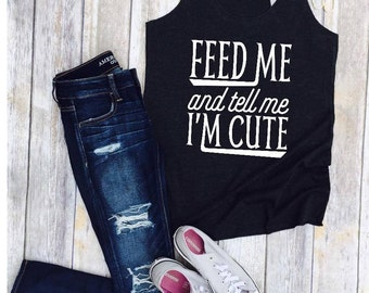 Feed Me and tell me I'm Cute/Woman's Racer Back Tank Top