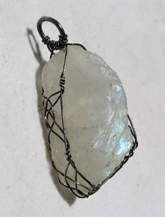 Rough rainbow moonstone pendant wrapped Celtic style with oxidized silver