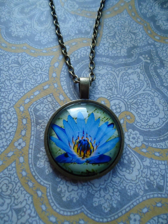 Blue lotus bronze round glass keychainnecklace i love flowers blue lotus bronze round glass keychainnecklace i love flowers blue lotus buycottarizona Choice Image
