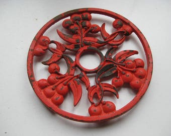 Vintage French red cast iron coaster.