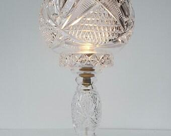 An exeptional high quality diamond cut crystal table lamp by F&C Osler