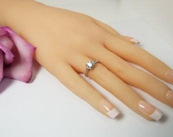 Exquisite Estate Vintage Diamond Platinum Solitaire Ring, Circa 1920, size 6, Old European cut diamond with 6 side diamonds, 0.90 ct TW