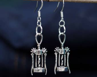Playful earrings with silver corkscrew