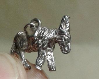 A solid sterling silver donkey bracelet charm