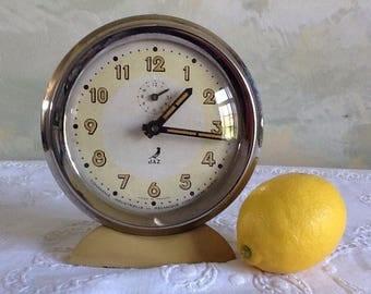 Vintage French non-working alarm clock. Jaz mechanical clock. Large 1950's industrial clock in metal. Beige, very clean decorative clock.