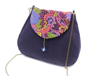 Navy blue messenger bag enhanced with plum cotton patterned with mauve and pink flowers