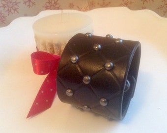 Women's Black leather studded cuff.