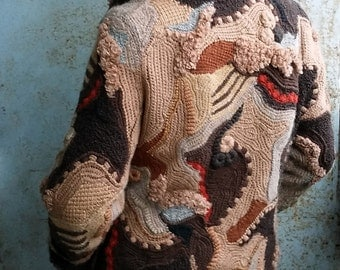 Women's winter knitted jacket in the style of freeform, patchwork