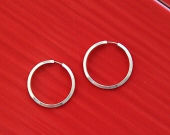 Silver vintage beautiful hoop earrings.