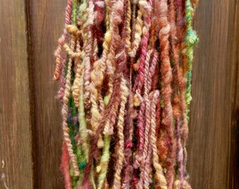 CORAL art yarn / wool / soft / knitting weaving felting / purple- yellow- and greentones / hand spun / hand dyed