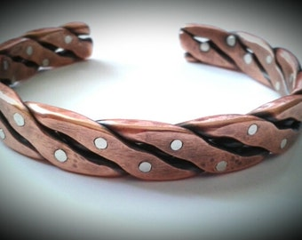 Heavy copper braided bracelet with silver rivets