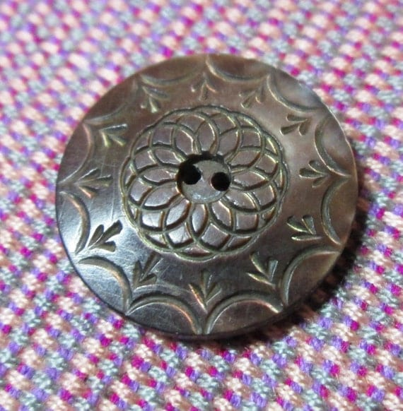 Carved shell button vintage mop with pink tones from