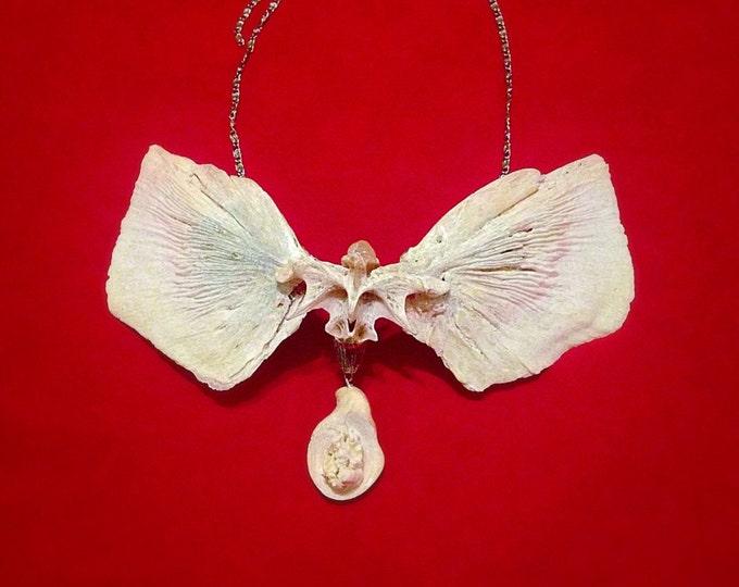 Stunning suspension of bone with gem quartz