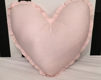 Pink stuffed heart cushion