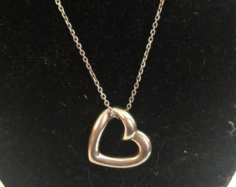 Beautiful solid sterling silver heart pendant on silver 18 inch long chain