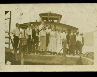 c.1910 Sistersville WV real photo postcard with id'd teens on dock