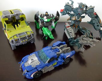 Transformers toy Lot,Battle damage,parts,repair, 80's cartoon,robot,truck,dinosaur,car,grimlock,rachet,The Fallen,topspin,toys