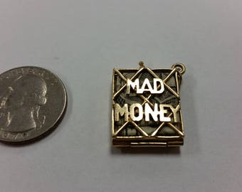 "Vintage 14k yellow gold ""mad money"" charm."