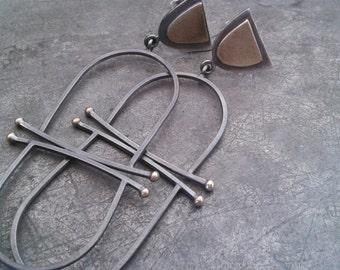 Μodernist  asymmetry light and  long  oxidized silver earrings with brass details