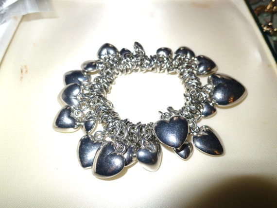 Vintage 1970s chunky silvertone bracelet with loads of silver heart charms