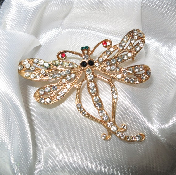 Lovely 1960s Art Deco styled goldtone rhinestone dragonfly brooch