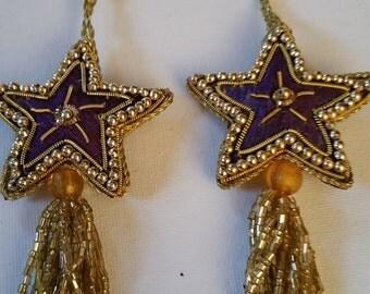 2 gold beaded star tassel