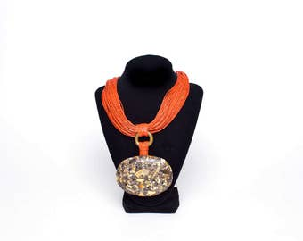 Leather necklace with crushed bone pendant design