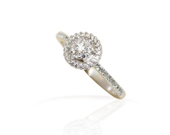 18kt white gold natural diamonds delicate Ladies ring.