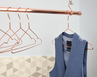 A Set of 5 Copper Clothes Hangers