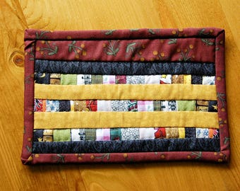 Red, black and gold and scrappy stripe mug rug