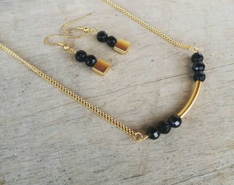 Minimalist black and gold necklace, black and gold earrings, jewelry set, arc necklace, curved pendant, black spinal