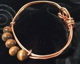 Copper bracelet with wood beads