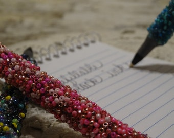 Refillable beaded ink pens