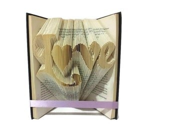 Love with heart book folding pattern. DIY Valentine's gift. Word love with heart for o. Create your own book sculpture. Free tutorial