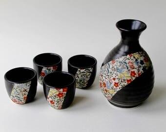 Vintage traditional Japanese Sake set. 1970's brown Sake bottle with four sake drinking cups. In deep brown with a floral flash design.