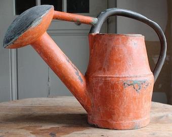 Early loop handled watering can