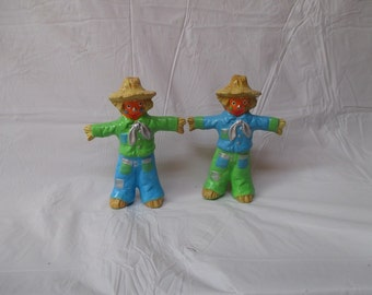 A pair of small scarecrows