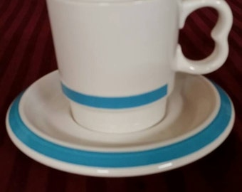 Shenango china restaurant ware. Coffee cup and saucer. White with blue trim.