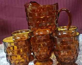 Amber pitcher with 5 glasses. Square diamond pattern.