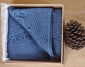 Knitted triangular blue shawl